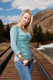 Woman on Railroad Tracks Stock Image