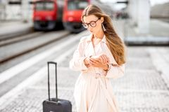 Woman at the railway station Stock Photography