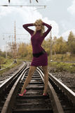 Woman on railway tracks Stock Images