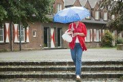 Woman in rain Stock Photos