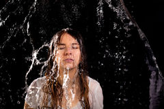 Woman rain black background royalty free stock photo