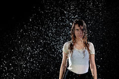 Woman rain black background royalty free stock images