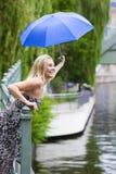 Woman in the rain Stock Photography