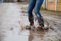 Woman with rain boots jumps Royalty Free Stock Photo