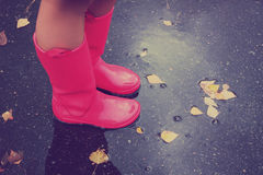 Woman in rain boots Royalty Free Stock Photo
