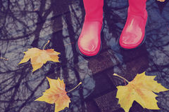 Woman in rain boots Royalty Free Stock Photography