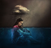 Woman and rain cloud. A woman rained on by a single cloud Stock Photos
