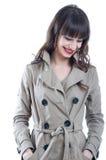 Woman in a rain coat Royalty Free Stock Image
