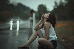 Woman in the rain and sad. Royalty Free Stock Photo