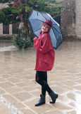 Woman in the rain with an umbrella Stock Images