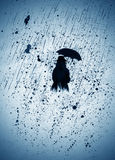 Woman in the rain with an umbrella Royalty Free Stock Image