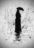 Woman in the rain under an umbrella Stock Images