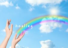 Woman and rainbow as source of healing energy on sunny day