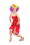 Woman in rainbow clown wig with freckles posing Stock Image