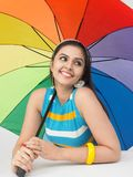Woman with a rainbow umbrella Stock Images