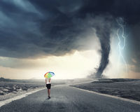 Woman with rainbow umbrella. Young pretty businesswoman with rainbow colorful umbrella walking in storm Royalty Free Stock Photo