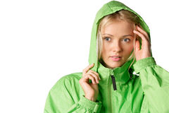 Woman in raincoat. Young woman wearing green hooded mackintosh isolated on white background Royalty Free Stock Image