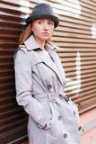 Woman in a raincoat Stock Photos