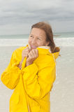 Woman raincoat autumn storm at beach Royalty Free Stock Image