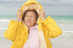 Woman raincoat autumn weather at beach Stock Photo