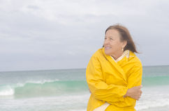 Woman raincoat autumn weather at beach Stock Photos