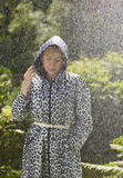 Woman and raincoat Royalty Free Stock Photos