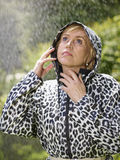 Woman and raincoat Royalty Free Stock Photo