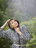 Woman and raincoat Stock Image