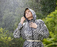 Woman and raincoat Royalty Free Stock Image