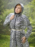 Woman and raincoat Stock Photos