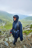 Woman in raincoat on mountain Royalty Free Stock Photo