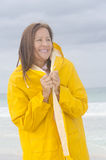 Woman raincoat rainy weather at beach Stock Photography