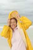 Woman raincoat seasonal storm at beach Royalty Free Stock Images