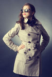 Woman in the raincoat and sunglasses Stock Image