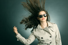 Woman in the raincoat and sunglasses Royalty Free Stock Image