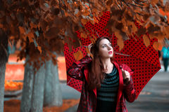 Woman in a raincoat and an umbrella Stock Photo