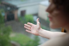 Woman and raindrops Royalty Free Stock Image