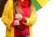 Woman in rainproof coat under umbrella Stock Photo