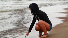 Woman in a rainy day at the seaside stock video