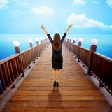 Woman Raise Hand On The Pier Stock Photography