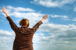 Woman with raised hands Royalty Free Stock Images