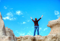 Woman with raised hands Stock Photo