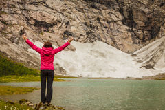 Woman with raised hands in norwegian mountains Royalty Free Stock Photo