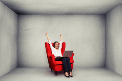 Woman with raised hands up in concrete room Royalty Free Stock Photo