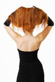 Woman with raised red hair and nude back Stock Image