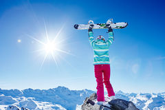 Woman with raised snowboard Royalty Free Stock Photo