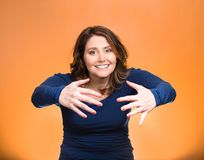 Woman with raised up palms arms at you offering hug stock photography