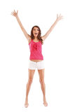 Woman raises her arms overhead Royalty Free Stock Photos