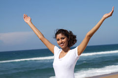 Woman raising arms Royalty Free Stock Image