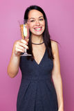 Woman raising a glass of champagne Stock Photo